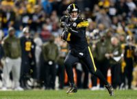Pittsburgh quarterback Ben Roethlisberger scrambles out of the pocket in the Steelers 52-21 NFL rout of the Carolina Panthers