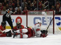 Canes hold on to beat Blackhawks 4-3, spoil Colliton's debut