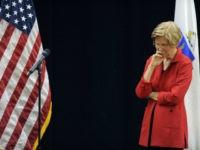 US Senator Elizabeth Warren (D-MA) listens during a town hall meeting in Roxbury, Massachusetts, October 13, 2018. (Photo by Joseph PREZIOSO / AFP) (Photo credit should read JOSEPH PREZIOSO/AFP/Getty Images)