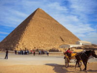 A picture taken on December 6, 2017 shows a view of the Great Pyramid of Khufu (also spelled Cheops) on the Giza Plateau on the southwestern outskirts of the capital Cairo. / AFP PHOTO / MOHAMED EL-SHAHED (Photo credit should read MOHAMED EL-SHAHED/AFP/Getty Images)