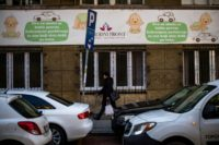 A woman walks in front of a maternity hospital in Belgrade. The government wants to boost the country's birth rate of 1.5 children per family, one of the lowest in Europe