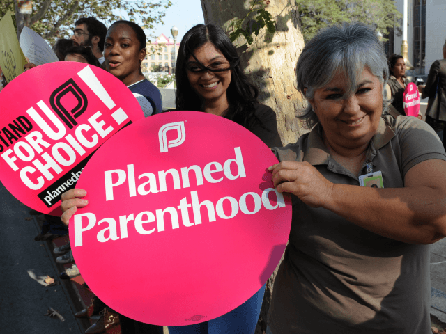 Members of the 'Planned Parenthood' women's rights group protest against the 'Stupak Ammendment' which they say will ban private abortion coverage for millions of American women, outside the Federal Courthouse in Los Angeles on November 20, 2009. Rights advocates have accused the most pro-choice US government in decades of throwing women under the bus after lawmakers tagged on an amendment restricting abortion access and funding to the health care reform bill. The amendment would bar the proposed federal government insurance program, known as the 'public option,' from paying for abortion, except to save the life of the mother or in cases of rape or incest. AFP PHOTO/Mark RALSTON (Photo credit should read MARK RALSTON/AFP/Getty Images)