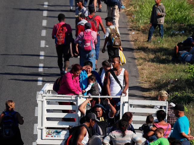 Central American migrants, part of the caravan hoping to reach the U.S. border, move on a road in Tapachula, Chiapas State, Mexico, Friday, Jan. 18,2019. Hundreds of Central American migrants are walking and hitchhiking through the region as part of a new caravan of migrants hoping to reach the United …