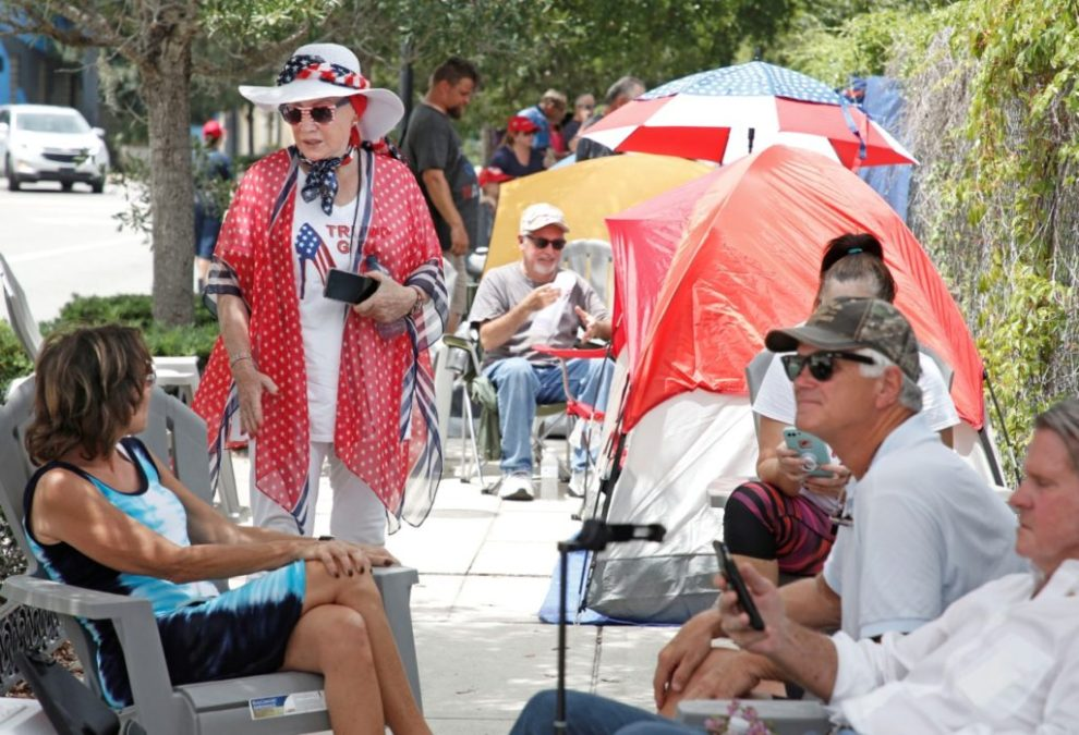 Supporters of US President Donald Trump line up along one of the main streets outside the Amway Center on June 17, 2019 some 40 hours before a Trump campaign event in Orlando, Florida. - President Trump is expected to launch his 2020 re-election campaign here on Tuesday night. (Photo by Gregg Newton / AFP) (Photo credit should read GREGG NEWTON/AFP/Getty Images)