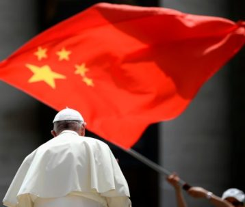 A worshipers waves the flag of China as Pope Francis leaves following the weekly general audience on June 12, 2019 at St. Peter's square in the Vatican. (Photo by Filippo MONTEFORTE / AFP) (Photo credit should read FILIPPO MONTEFORTE/AFP/Getty Images)