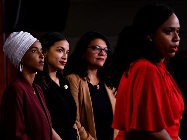 """US Representatives Ayanna Pressley (D-MA) speaks as, Ilhan Abdullahi Omar (D-MN)(L), Rashida Tlaib (D-MI) (2R), and Alexandria Ocasio-Cortez (D-NY) hold a press conference, to address remarks made by US President Donald Trump earlier in the day, at the US Capitol in Washington, DC on July 15, 2019. - President Donald Trump stepped up his attacks on four progressive Democratic congresswomen, saying if they're not happy in the United States """"they can leave."""" (Photo by Brendan Smialowski / AFP) (Photo credit should read BRENDAN SMIALOWSKI/AFP via Getty Images)"""