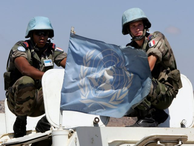 A UN flag flutters atop an armoured personnel carrier as UNIFIL French Foreign Legion soldiers observe the landscape during a patrol in the area outside the southern Lebanese border town of Ain Ebel, 05 September 2006. Lebanese troops should soon control their southern border for the first time in decades, …