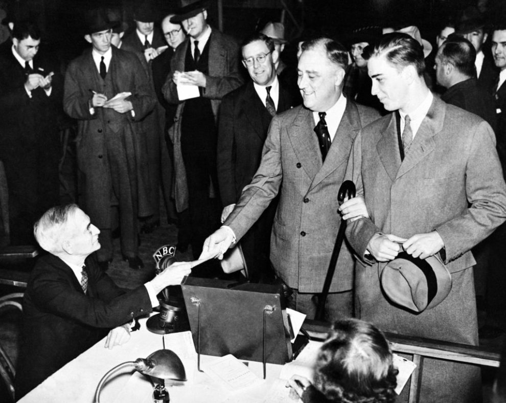 President Franklin D. Roosevelt, accompanied by his son, Franklin Jr., casting his vote at the Town Hall, at Hyde Park, in the New York during the presidential elections, on Nov. 3, 1936. (AP Photo)