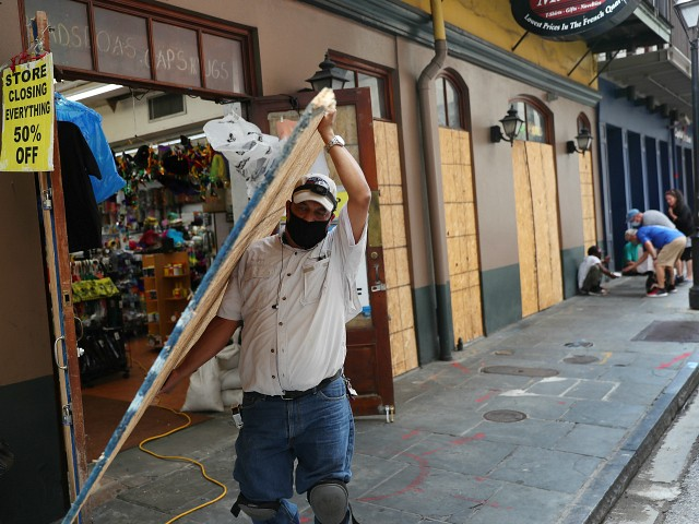 NEW ORLEANS, LOUISIANA - SEPTEMBER 14: Luis A. Sanabria puts plywood over the windows of a business in the historic French Quarter before the possible arrival of Hurricane Sally on September 14, 2020 in New Orleans, Louisiana. The storm is threatening to bring heavy rain, high winds and a dangerous storm surge from Louisiana to Florida. (Photo by Joe Raedle/Getty Images)