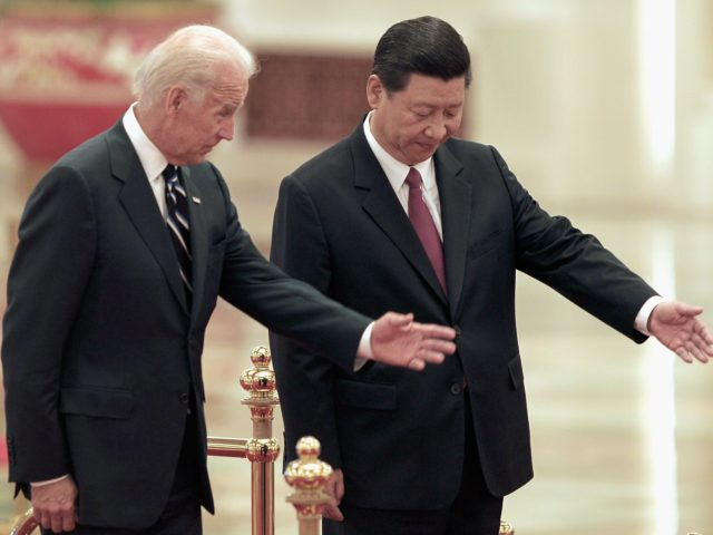 BEIJING, CHINA - AUGUST 18: Chinese Vice President Xi Jinping invites U.S. Vice President Joe Biden (L) to view an honour guard during a welcoming ceremony inside the Great Hall of the People on August 18, 2011 in Beijing, China. Biden will visit China, Mongolia and Japan from August 17-25. …