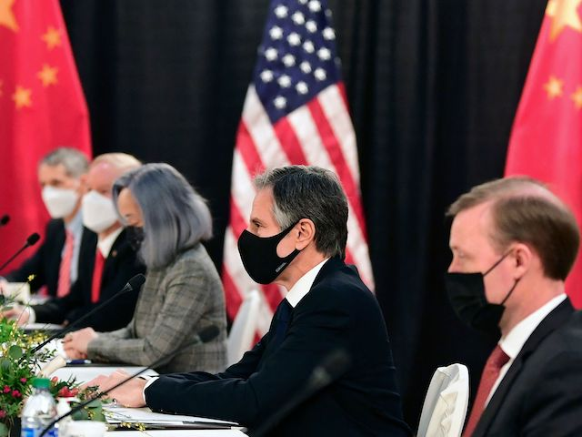 The US delegation led by Secretary of State Antony Blinken (C), flanked by US National Security Advisor Jake Sullivan (R), face their Chinese counterparts at the opening session of US-China talks at the Captain Cook Hotel in Anchorage, Alaska on March 18, 2021. (Photo by Frederic J. Brown/AFP via Getty Images)
