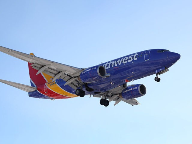 CHICAGO, ILLINOIS - JANUARY 28: A Southwest Airlines jet lands at Midway International Airport on January 28, 2021 in Chicago, Illinois. Southwest Airlines today reported its first annual loss since 1972. The coronavirus (COVID-19) pandemic has wreaked havoc on the industry in 2020 with U.S. airlines reporting a combined $34 …