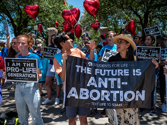 Pro-life protesters stand near the gate of the Texas state capitol at a protest outside the Texas state capitol on May 29, 2021 in Austin, Texas. Thousands of protesters came out in response to a new bill outlawing abortions after a fetal heartbeat is detected signed on Wednesday by Texas Governor Greg Abbot. (Photo by Sergio Flores/Getty Images)