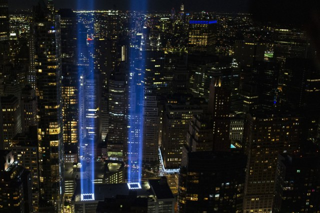NEW YORK, NEW YORK - SEPTEMBER 11: The Tribute In Light shines up from Lower Manhattan on the 20th Anniversary of the terror attacks on September 11, 2021 in New York City. During the ceremony six moments of silence were held, marking when each of the World Trade Center towers was struck and fell and the times corresponding to the attack on the Pentagon and the crash of Flight 93. The nation is marking the 20th anniversary of the terror attacks of September 11, 2001, when the terrorist group al-Qaeda flew hijacked airplanes into the World Trade Center, Shanksville, PA and the Pentagon, killing nearly 3,000 people. (Photo by Michael M. Santiago/Getty Images)