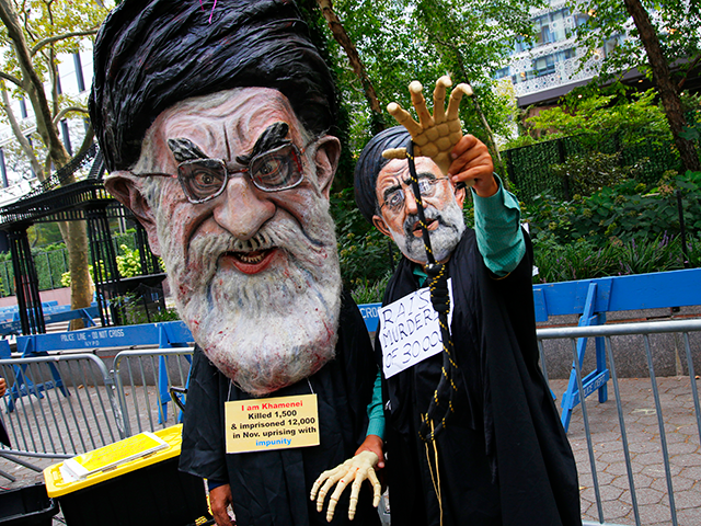 People protest Iranian President Ebrahim Raisi near the United Nations General Assembly on September 21, 2021 in New York City. The 76th session of the UN General Assembly began today with more than 100 heads of state or government attending in person, although the size of delegations are smaller due to the Covid-19 pandemic. (Photo by Michael M. Santiago/Getty Images)