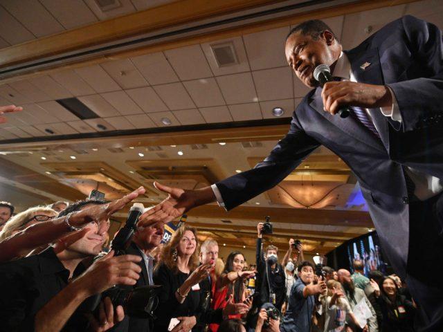 Larry Elder handshakes (Robyn Beck / AFP / Getty)