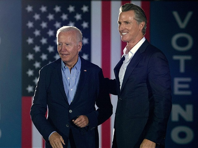 California Governor Gavin Newsom (L) greets US President Joe Biden during a campaign event at Long Beach City Collage in Long Beach, California on September 13, 2021. - US President Joe Biden kicked off a visit to scorched western states Monday to hammer home his case on climate change and big public investments, as well as to campaign in California's recall election. (Photo by Brendan Smialowski / AFP) (Photo by BRENDAN SMIALOWSKI/AFP via Getty Images)