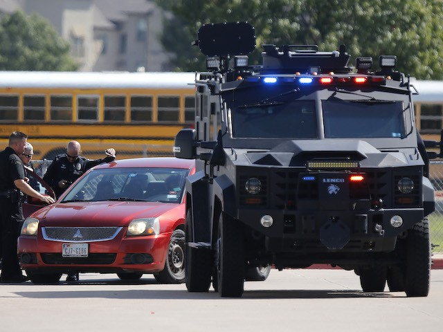 Emergency personnel work the scene in the parking lot at Timberview High School after a student used a gun on campus on October 6, 2021 in Arlington, Texas. (Stewart F. House/Getty Images)