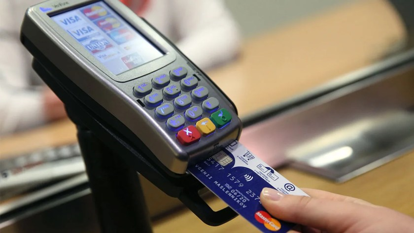Woman using the chip credit card reader