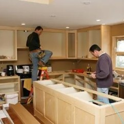 Kitchen Rehab Hutch For How Much Does It Cost To Remodel A Men Working On Cabinets George Peters Getty Images