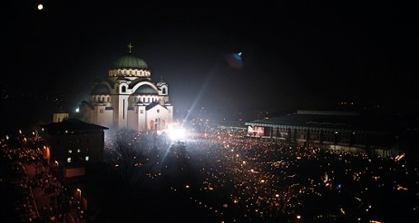 Thousands of Serbs burn candles and pray in front of Serbia's main Orthodox cathedral