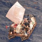 Cubans rescued from sinking raft at sea