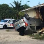 Car smashes into wooden building