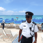 Cops mix and mingle on Seven Mile Beach