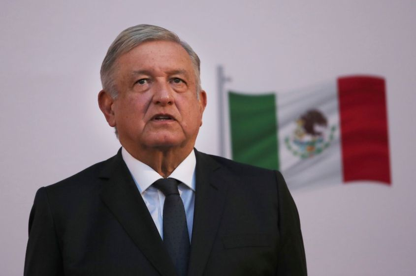 Mexican President Andrés Manuel López Obrador stands during the commemoration of his second anniversary in office, at the National Palace in Mexico City, on Tuesday, December 1, 2020.