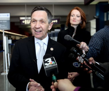 KUCINICH-AIRPORT-SMILING.JPG
