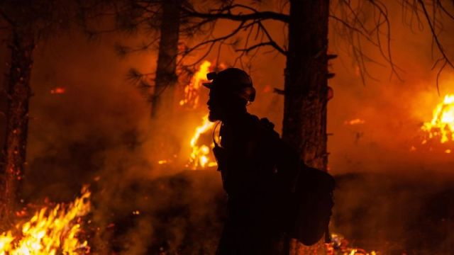 A firefighter battles the Bootleg Fire in the Fremont-Winema National Forest, along the Oregon and California border, on July 15.