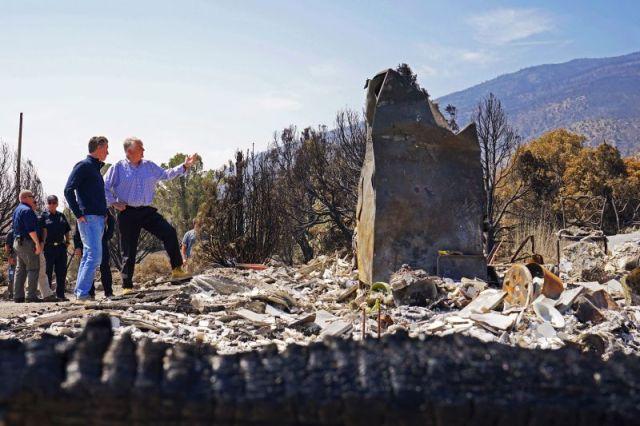 California Gov. Gavin Newsom, left, and Nevada Gov. Steve Sisolak tour an area destroyed by the Tamarack Fire in Gardnerville, Nevada, on July 28.