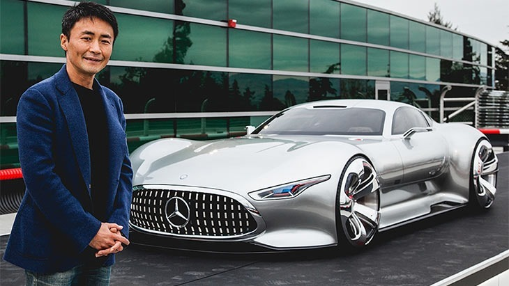 A rare picture of Kazunori Yamauchi standing next to a car that ISN'T a Nissan Skyline