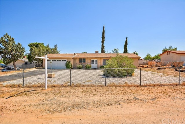 Beautiful 3 bedroom 2 bath home! Entry & Large living room with custom interior paint & upgraded laminate flooring, kitchen has updated with white cabinets, newer counter tops & upgraded laminate flooring. Almost half acre fenced lot with large storage shed.