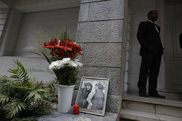 """A photo of the late Fidel Castro, pictured on left of frame, with Ernesto """"Che"""" Guevara, is propped against a wall at the entrance of the Cuban Embassy in Buenos Aires, Argentina, Monday, Nov. 28, 2016. Castro, who led a rebel army to improbable victory, embraced Soviet-style communism and defied the power of 10 U.S. presidents during his half century rule of Cuba, died Friday at age 90. (AP Photo/Victor R. Caivano)"""