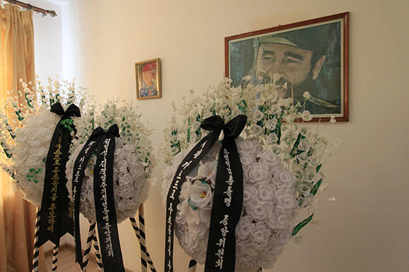 Wreaths are laid in front of a portrait of the late Fidel Castro at the mourning room of the Cuban embassy in Pyongyang, North Korea, Tuesday, Nov. 29, 2016. North Korea is observing a three-day period of mourning for Castro, who was seen by the North as a comrade-in-arms against the common enemy of the United States. Castro died Friday at age 90. (AP Photo/Jon Chol Jin)