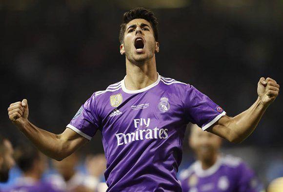 Marco Asensio celebra su gol, el que cerró la goleada. Foto: Reuters.