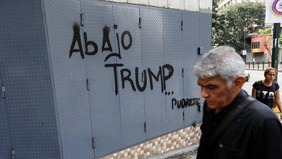 Pintado contra Trump em Caracas, Venezuela capita. Foto: AP.