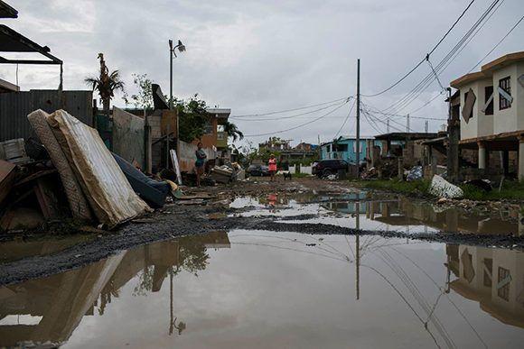 La Villa Hugo, en Canóvanas, permanece inundada después de tres semanas de que el huracán María arrasó la isla. Cada vez hay más reportes de enfermedades causadas por la contaminación de las aguas de la inundación que dejó el huracán. Foto: Dennis M. Rivera Pichardo/ The New York Times.
