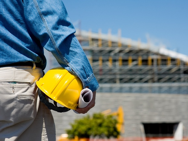 construction worker at construction site with hard hat