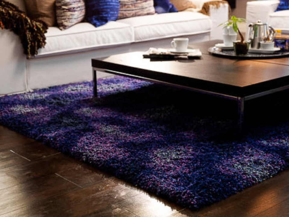 Area rugs to define your room  and keep your toes
