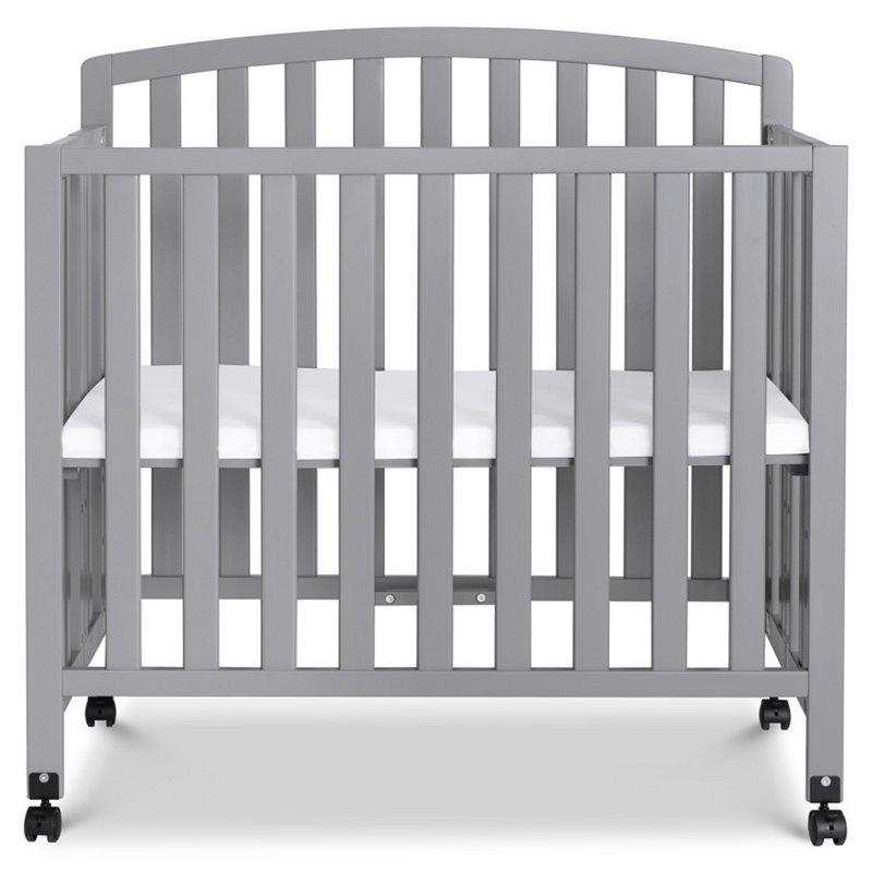 davinci dylan folding portable 3 in 1 mini crib and twin bed in gray
