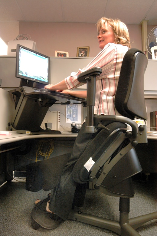 Ergonomic chair desk system helps civilian stand to work