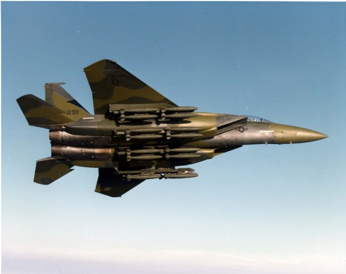 Prototype F-15E in flight with a full load of bombs . (U.S. Air Force photo)