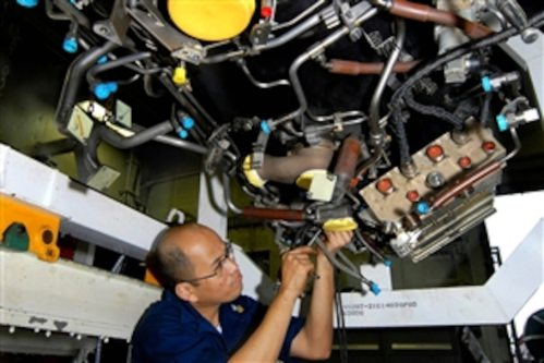 small resolution of u s navy petty officer 1st class james gregorio installs a wiring harness on an f