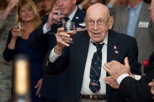 "Retired Lt. Col. Dick Cole, co-pilot of Aircraft No. 1 of the Doolittle Tokyo Raid, raises a glass to toast the 74th anniversary of the Doolittle Raid April 18 at Joint Base San Antonio-Randolph. On the same day in 1942, Lt. Col. James H. ""Jimmy"" Doolittle led a select team of 80 pilots, gunners, navigators and bombardiers to execute a surprise attack over the islands of Japan in retaliation after the sneak attack at Pearl Harbor Dec. 7, 1941.  Cole, at 100-years-old, is one of two remaining survivors of the Doolittle Raid.  Staff Sgt. David Thatcher, who was unable to attend, is the second survivor."