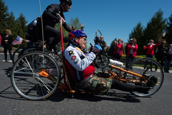 Vietnam War Army veteran Bill Czyzewski rides a recumbent bicycle to the applause of a crowd in Gettysburg, Pa., April 24, 2016. More than 150 disabled veteran cyclists were paired amongst 600 able-bodied cyclists to ride 110 miles from Arlington, Va., to Gettysburg over two days in honor of veterans and military members. DoD photo by EJ Hersom