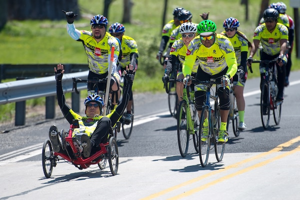 Retired Army Sgt. Albert Gonzalez sets pace for the Rescue 22 team during the Face of America bike ride in Gettysburg, Pa., April 24, 2016. More than 150 disabled veteran cyclists were paired amongst 600 able-bodied cyclists to ride 110 miles from Arlington, Va., to Gettysburg over two days in honor of veterans and military members. DoD photo by EJ Hersom