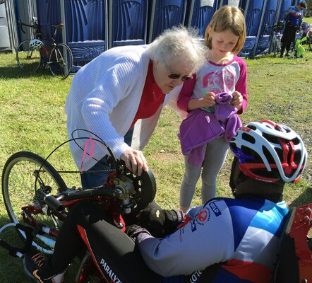 Virginia Wantz and her granddaughter, Autumn Schaffer, thank medically retired Army Sgt. 1st Class Carl Morgan for his military service at a rest stop in Pennsylvania during the World T.E.A.M.'s Face of America ride, April 24, 2016. More than 700 cyclists, 175 of them disabled veterans, rode 110 to 120 miles from either Arlington, Va., or Valley Forge, Pa., to Gettysburg over two days. DoD photo by Shannon Collins