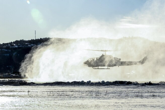 A Marine Corps AH-1W Super Cobra helicopter kicks up snow in Vaernes, Norway, Feb. 22, 2016, as the 2nd Marine Expeditionary Brigade prepares for Exercise Cold Response. The joint exercise includes about 16,000 troops and 12 NATO allies and partnered nations. Marine Corps photo by Cpl. Dalton A. Precht